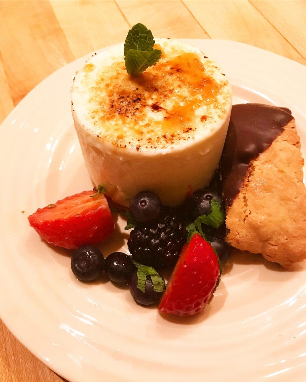 Creme brûlée cheesecake, traditional biscotti, half dipped chocolate and wine and mint marinated mixed berries